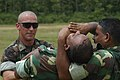 US Navy 030909-M-9812M-021 Marine, Staff Sergeant Rusty W. Stowers provides guidance and supervision during hands on training to Bangladesh Army personnel during a Non-Lethal Weapons Seminar.jpg