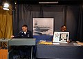 US Navy 040501-N-7871M-028 Aviation Structural Mechanic 1st Class Matthew Nichols, of New Carlisle, Ohio, left, picks bingo numbers.jpg