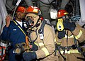 US Navy 040612-N-2591H-002 Damage Control Training Team (DCTT) member Hospital Corpsman 2nd Class Renville Marsh observes the nozzle man as the On-Scene Leader uses the Naval Firefighter Thermal Imager.jpg