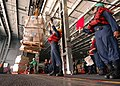 US Navy 040623-N-6278K-038 Deck Department crewmembers receive stores from the fast combat support USNS Supply (T-AOE 6).jpg