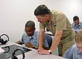 US Navy 040804-N-5011B-001 Seaman Julius Johnson takes Master Chief Petty Officer of the Navy (MCPON) Terry Scott on a virtual submarine tour.jpg