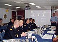 US Navy 041001-N-9336V-002 Rear Adm. Sergy Avakyants, Rear Adm. Aleksandr Poroshin, second and third from left, and other officers of the Russian Federation Navy, convene in the wardroom of the guided missile cruiser USS Hue Ci.jpg