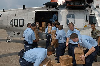 Stafford Disaster Relief and Emergency Assistance Act - Image: US Navy 050901 N 0438A 013 Sailors stationed on board Naval Air Station Pensacola load supplies on a UH 3H helicopter before it is transported to New Orleans to aide in disaster relief efforts for the Hurricane Katrina victims
