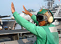 US Navy 051020-N-0119G-004 Aviation Boatswain's Mate 2nd Class Jerome Uter gives the ready signal to launch an F-A-18 Hornet.jpg