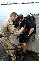 US Navy 060313-F-9074R-016 U.S. Navy explosive ordnance disposal (EOD) Sailors perform an equipment check prior to performing a routine force protection dive at the Port of Djibouti.jpg