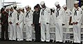 US Navy 060614-N-6700F-034 U.S. Sailors, Marines and Soldiers bow their heads in prayer at the conclusion of a naturalization ceremony held aboard the Nimitz-class aircraft carrier USS George Washington (CVN 73).jpg