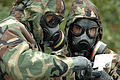 US Navy 061027-N-4515N-227 Explosive Ordnance Technician 2nd Class Ian Jordan and Lt. j.g. Eric Hui from Explosive Ordnance Disposal Mobile Unit Two (EODMU-2), run tests on substances for an exercise on chemical warfare.jpg