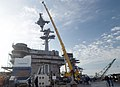 US Navy 070221-N-1317P-006 A portion of a newly manufactured mast is lifted via crane onto the superstructure of USS Carl Vinson (CVN 70) by employees from Northrop Grumman Newport News shipyard.jpg