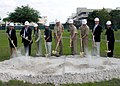 US Navy 070530-N-9830B-005 ..Tom Tryon, of Public Works Department Jacksonville, and Ralph Kaneshiro of NAVFAC Southeast break ground to commence construction of the new NAVFAC Southeast Headquarters building aboard Naval Air.jpg