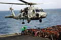 US Navy 070603-N-3262C-006 Sailors from Helicopter Squadron Combatant (HSC) 23 attach a hook to the bottom of an SH-60 Seahawk.jpg