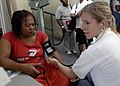 US Navy 070919-N-6278K-106 Laura Seris, a registered nurse and Project Hope volunteer attached to Military Sealift Command hospital ship USNS Comfort (T-AH 20), takes a blood pressure reading from a patient.jpg