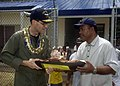 US Navy 080830-N-0209M-006 Vice Admiral John Bird receives a gift from a village official.jpg