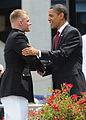 US Navy 090522-N-0593C-696 U.S. President Barack Obama congratulates a new Marine Corps 2nd lieutenant on his commissioning into the U.S. Marine Corps during a graduation and commissioning ceremony at Navy-Marine Corps Memorial.jpg