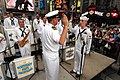 US Navy 090524-N-5681S-197 Lt. Carl Gerhard, director of the U.S. Navy Band Northeast, re-enlists a Musician 3rd Class in Times Square during Fleet Week New York City 2009.jpg