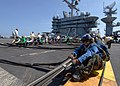 US Navy 090626-N-6720T-028 Sailors assigned to the air department of the aircraft carrier USS George Washington (CVN 73) prepare to raise an aircraft barricade during flight deck drills.jpg