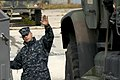 US Navy 091027-N-3592S-153 Engineman 2nd Class Stephen Weber, assigned to Landing Craft Utility 1655 (LCU 1655) directs the embarkation equipment from the 24th Marine Expeditionary Unit.jpg