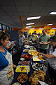 US Navy 100511-N-6046S-088 Navy personnel and families eat a free dinner during the monthly We Care Supper.jpg