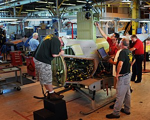 Northrop Grumman MQ-8 Fire Scout - An MQ-8B undergoes maintenance by civilian technicians at Marine Corps Air Station Cherry Point, 2010