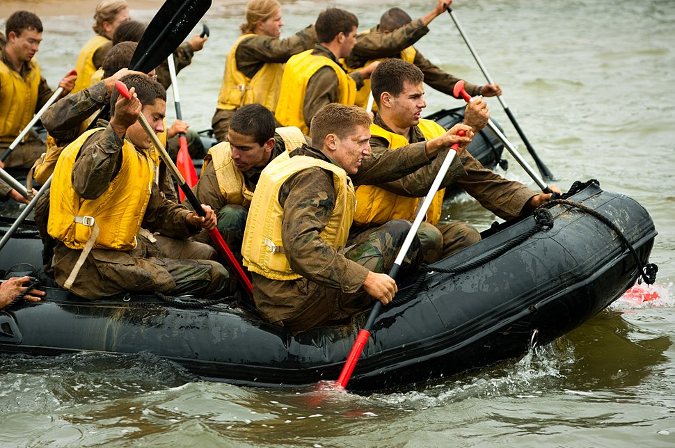 US Navy 100518-N-2069B-319 Plebes paddle pontoon boats during a team-building portion of Sea Trials at the U.S. Naval Academy
