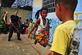 US Navy 100617-N-6597H-514 A Cambodian child plays jump rope with Aviation Boatswain's Mate (Handling) 1st Class Yissel Castanon.jpg