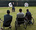 US Navy 101005-N-7981E-610 Retired Army Cpl. Kevin Stone teaches archery techniques to service members during the U.S. Olympic Committee Paralympic.jpg