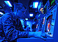 US Navy 101019-N-2218S-056 Fire Controlman 3rd Class Shane Nichlos tests a radar display in the combat information center aboard the amphibious ass.jpg