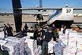 US Navy 101109-N-3570S-216 Sailors from Fleet Logistics Squadron (VRC) 30 load meat, bread and plastic dinnerware into C-2A Greyhound logistics air.jpg