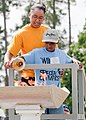 US Navy 110427-N-4010S-001 Religious Program Specialist Seaman Apprentice Jaleesa Overbey helps Da' Von Arline light the Special Olympics torch.jpg