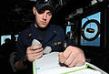 US Navy 110513-N-TB177-057 nsign Ross F. Hammerer, the communications officer aboard the guided-missile destroyer USS Truxtun (DDG 103), records ra.jpg