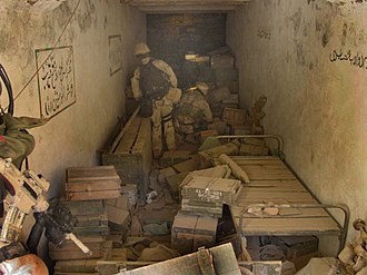 United States Navy SEALs - Task Force K-Bar SEALs searching munitions found in the Zhawar Kili cave complex