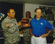 University of Kentucky President Lee Todd, Jr. receives an award from Army General Albert Bryant, Jr.