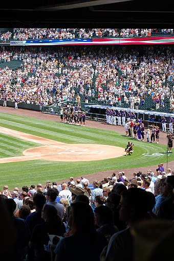 Crowd performing the U.S. national anthem before a baseball game at Coors Field Usnationalanthemcrowd.jpg