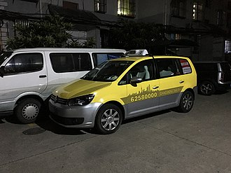 Public transport in Shanghai - A typical VW Touran Taxi in Shanghai