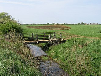 Vale of Pickering - Footbridge over Welldale Beck, a stream issuing as a spring at the base of the North York Moors.