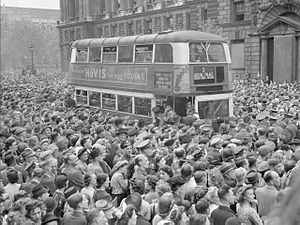 Bus transport in the United Kingdom - Double-decker bus slowly pushes its way through the huge crowds gathered in Whitehall to hear Churchill's Victory speech, 8 May 1945