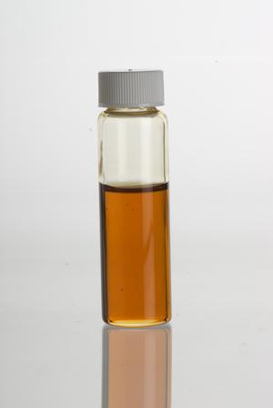Chrysopogon zizanioides - Vetiver (Vetiveria zizanioides= Chrysopogon zizanioides) essential oil in a clear glass vial