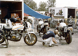 Reg Pridmore - 1979 Vetter team at Sears showing (at rear of machine 163) from left, Pierre des Roches, Reg Pridmore (seated, in white leathers) and Keith Code wearing short jacket
