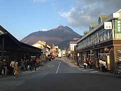 View of Mount Yufudake and Yufuin Onsen Street in front of Yufuin Station.JPG