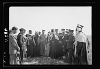 Visit to Beersheba Agricultural Station (Experimental) by Brig. Gen. Allen & staff & talks to Bedouin sheiks of district by station superintendent. Mixed group in field of grain listening to LOC matpc.20536.jpg