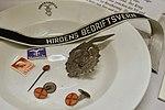 WW2 in Norway. Items of NS (Nasjonal Samling). Quisling stamp, suncross pin, Førergarden plate, Hirdens bedriftsvern cuffband, etc. Lofoten Krigsminnemuseum 2019-05-08 DSC09890.jpg