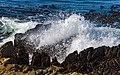 Wave breaking on rocky Robben Island shoreline.jpg