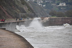 Waves breaking on the sea wall at Teignmouth (0121).jpg