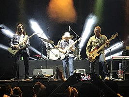 Weezer performing in 2019 at Musikfest in Bethlehem, Pennsylvania. From left to right: Brian Bell, Patrick Wilson, Rivers Cuomo, and Scott Shriner.