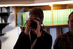 Mike Peel at WikiConference UK 2012, taking a photograph of the photographer.