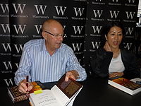"Wilbur Smith singing copy of ""Assegai"" - april 2009; London.jpg"
