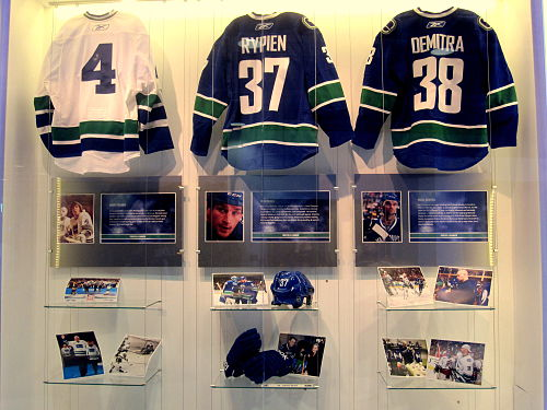 Following Rypien's death, the Canucks produced a display in the Rogers Arena concourse featuring his jersey, equipment and photos. (Also honoured in the display are Barry Wilkins (left) and Pavol Demitra (right), both of whom also died in the summer of 2011.) Wilkins Rypien and Demitra memorial.JPG