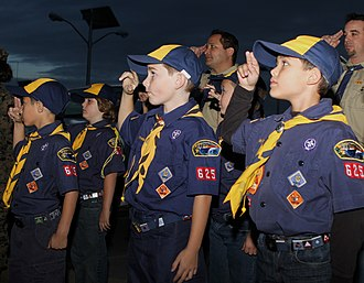 Two-finger salute - Cub Scouts of the Boy Scouts of America saluting.