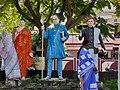 Women cleaning statues of Buddha, Dr. Ambedkar, and Mahatma Phule.jpg