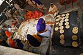 Women preparing roti for visitors of Harmandir Sahib.jpg