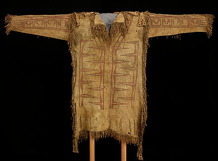 Leather Shirt, c. 1720-1750. This one-of-a-kind shirt was created in the early 18th century by Native Americans living in New France, and acquired by a French voyageur. Made of antelope hide, the interlocking abstract painted designs probably represent the sacred Thunderbird. Woodlands Shirt, c. 1720-1750.jpg
